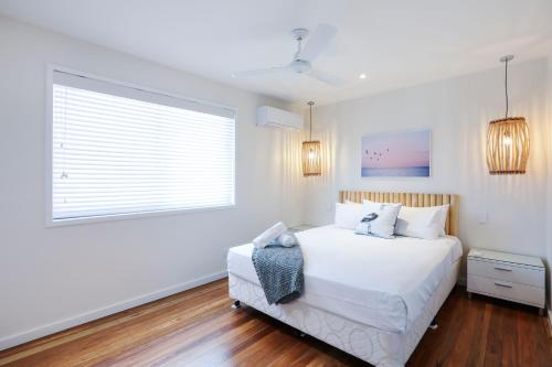 A bed or beds in a room at Sandbox Luxury Apartments