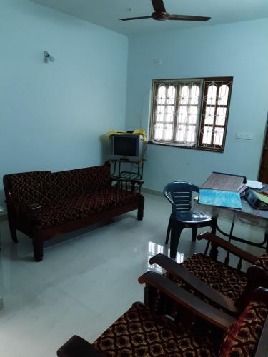 A seating area at Mahalaxmi Apartment
