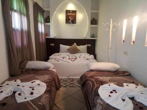 Un pat sau paturi într-o cameră la Riad 46