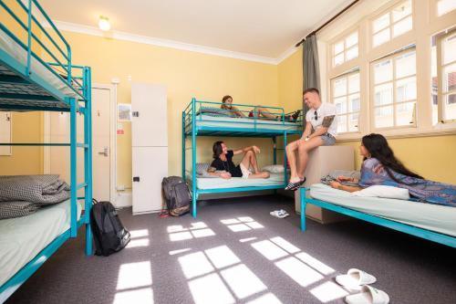 A bunk bed or bunk beds in a room at Newcastle Beach YHA
