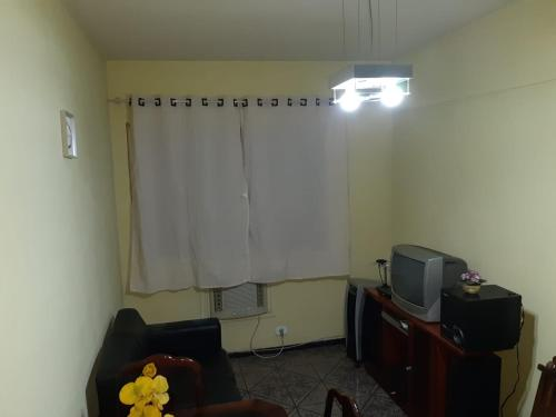 A television and/or entertainment center at Condomínio Argus