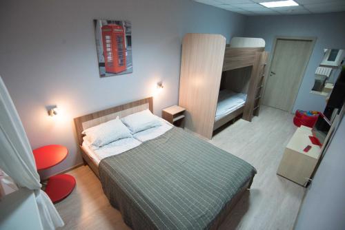 Кровать или кровати в номере Авантаж Хостел