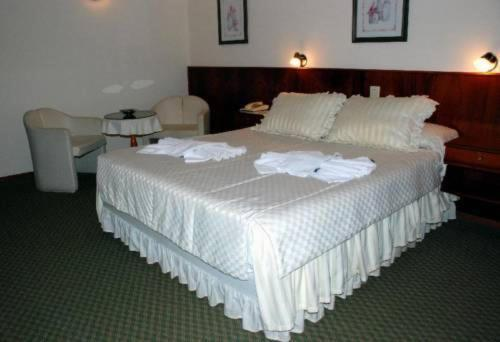 Кровать или кровати в номере Hotel La Posta