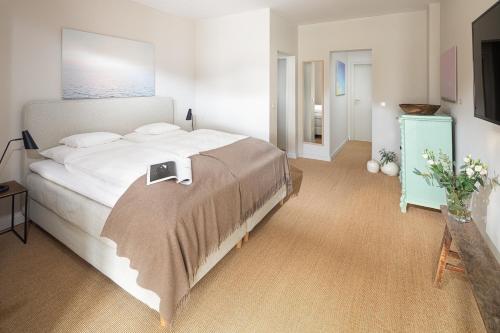 Ein Bett oder Betten in einem Zimmer der Unterkunft Friedrich Inn