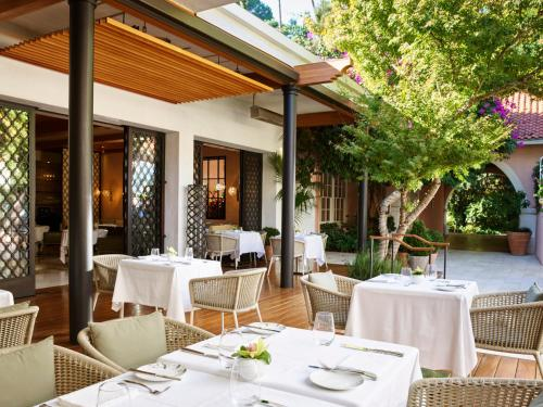 A restaurant or other place to eat at Hotel Bel-Air - Dorchester Collection