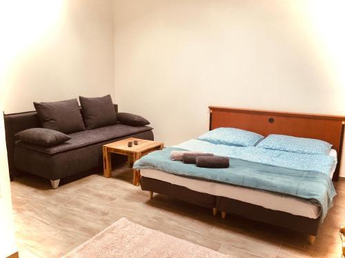 A bed or beds in a room at Apartmány Svatošské skály