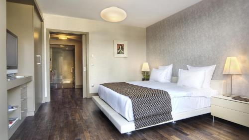 A bed or beds in a room at Sofa Hotel Istanbul, Autograph Collection
