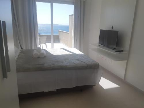 A bed or beds in a room at Orla 22 Búzios