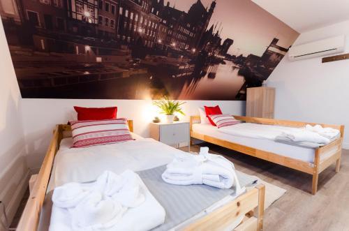 Un ou plusieurs lits dans un hébergement de l'établissement Elewator Gdańsk