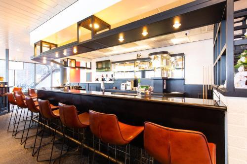 Лаундж или бар в Bastion Hotel Almere
