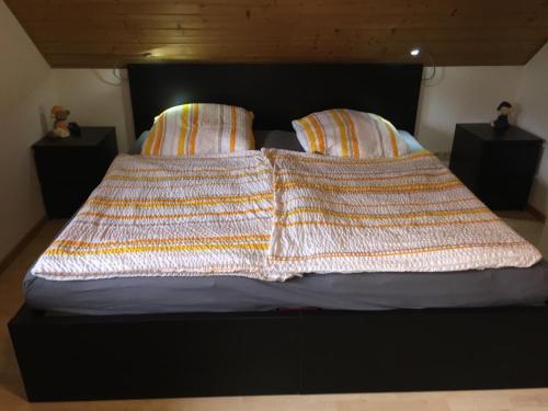 Ein Bett oder Betten in einem Zimmer der Unterkunft Exklusive Apartments in der Villa Eule