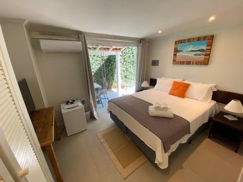 Una cama o camas en una habitación de Baía do João Eco Pousada