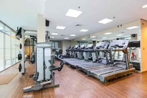 The fitness center and/or fitness facilities at Radisson Vila Olimpia