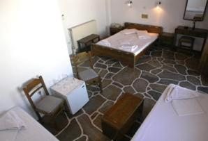 A bed or beds in a room at Silver Rocks Hotel