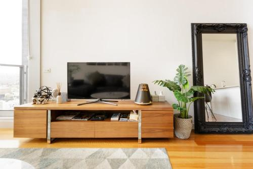 A television and/or entertainment center at Milano CBD Penthouse