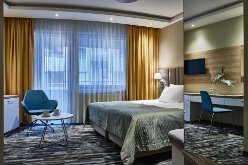 Łóżko lub łóżka w pokoju w obiekcie Hotel Dom Zdrojowy Resort & SPA