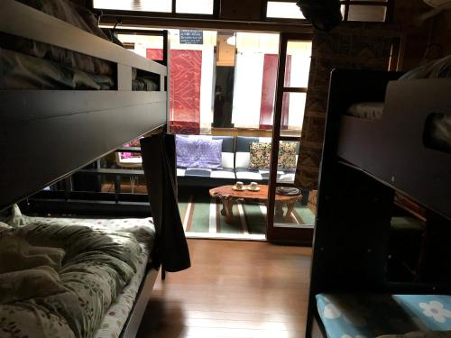 A bunk bed or bunk beds in a room at Kimono In Utakata