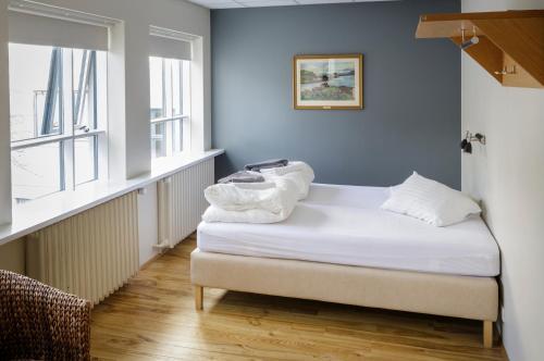 A bed or beds in a room at Reykjavik Downtown HI Hostel