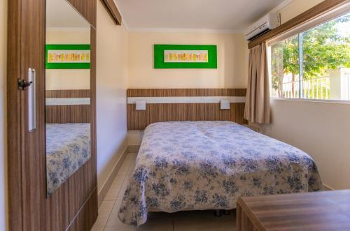 A bed or beds in a room at Apartamento Via Caldas L'Acqua II