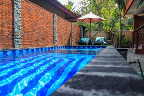 The swimming pool at or near D'Tegal House