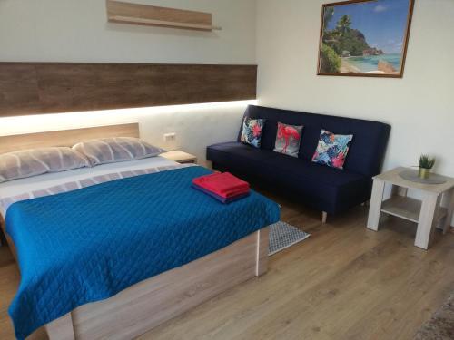 Łóżko lub łóżka w pokoju w obiekcie Willa Moja Przystań