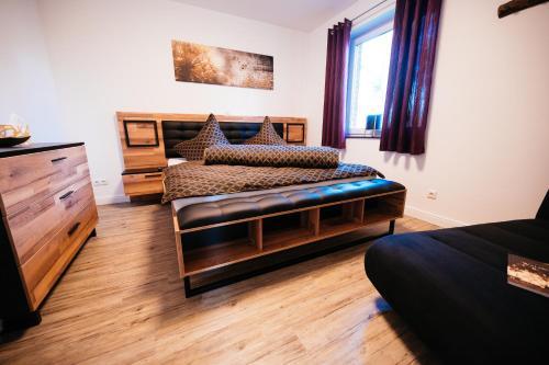 Postel nebo postele na pokoji v ubytování Ferienhaus Hünzingen № 2