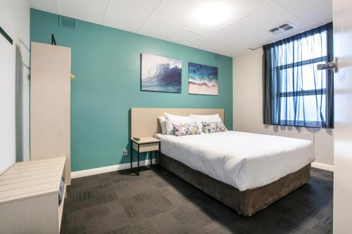 A bed or beds in a room at Nightcap at Watermark Glenelg