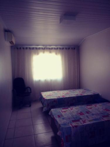 A bed or beds in a room at Casa no peró