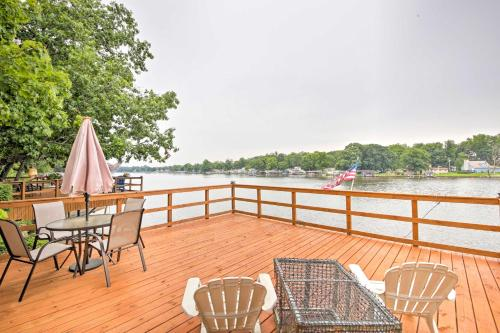 A balcony or terrace at 'Cozy Cottage' with Dock & Patio by Indiana Beach