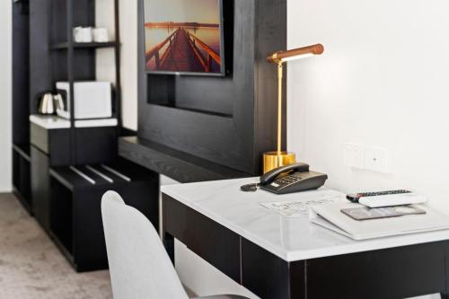 A television and/or entertainment center at WM Hotel Bankstown
