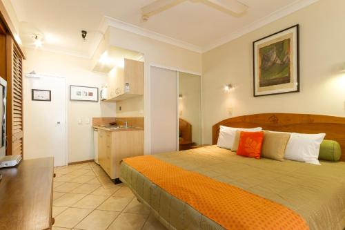 A bed or beds in a room at Hibiscus Resort And Spa Book Here With The Onsite Reception Open Daily