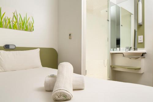 A bed or beds in a room at ibis budget Manchester Salford Quays