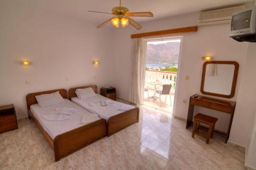 Ein Bett oder Betten in einem Zimmer der Unterkunft Seva' s Studios
