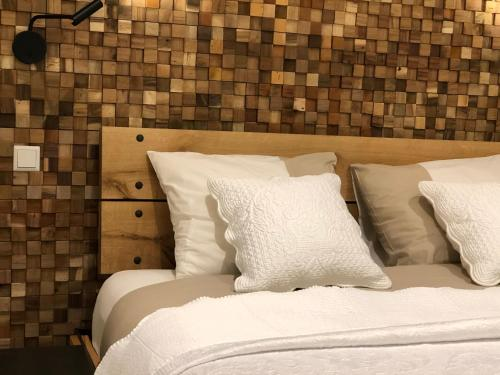 A bed or beds in a room at Loft 188 Stylish & Luxury apartment hotel