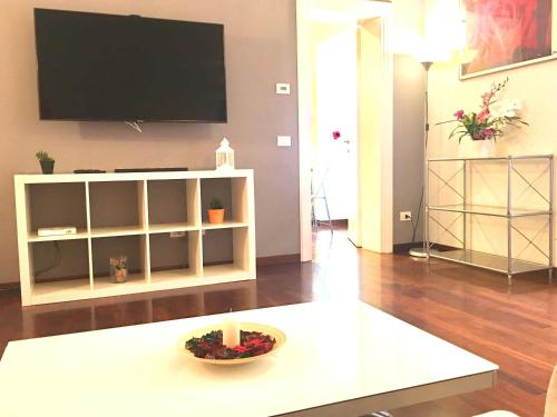 A television and/or entertainment centre at 8 HOME