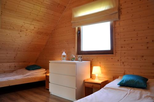 Łóżko lub łóżka w pokoju w obiekcie Słoneczny Przystanek