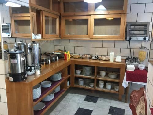 A kitchen or kitchenette at Hotel Kuč