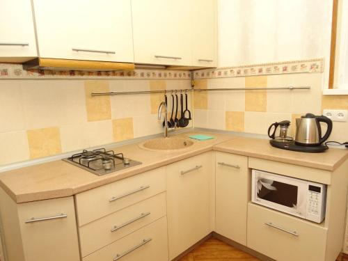 A kitchen or kitchenette at Garmoniya Guest House
