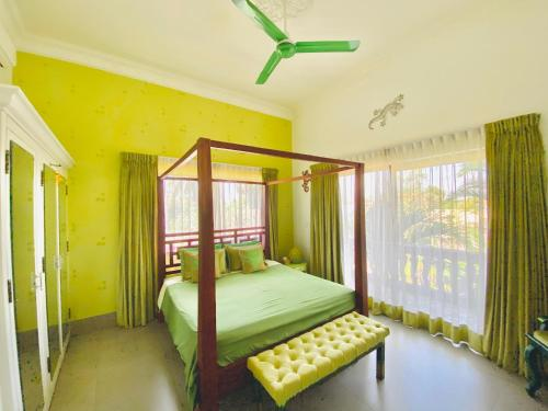 A bed or beds in a room at 3 Monkeys Villa Residence