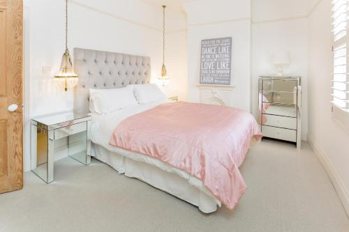 A bed or beds in a room at SPR Altrincham A Lovely Period Property House