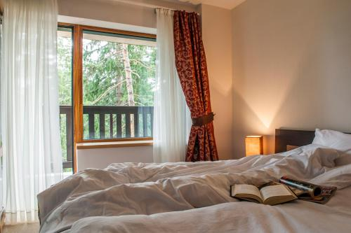 A bed or beds in a room at Pamporovo Central Apartments