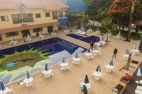 Uma vista da piscina em Resort Recanto do Teixeira All Inclusive ou nos arredores