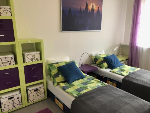 A bed or beds in a room at Apartment SCIROCCO Prague - Two Bedroom Apartment