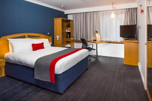 A bed or beds in a room at Holiday Inn Express East Midlands Airport