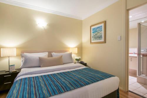 A bed or beds in a room at The Peninsula Riverside Serviced Apartments