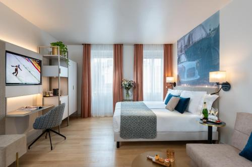 A bed or beds in a room at Leonardo Boutique Hotel Rome Termini
