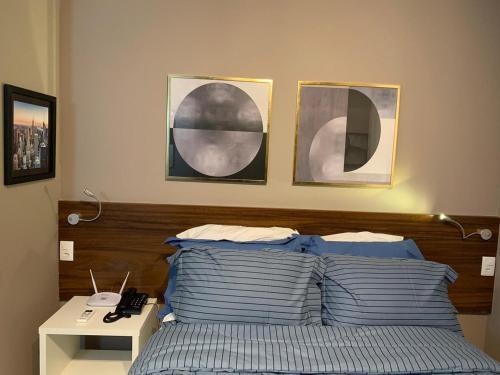 A bed or beds in a room at Fusion SHN Flat de luxo - Melhor localização de Brasília