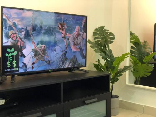A television and/or entertainment centre at Modern Scandinavian Studio Unit at Queensbay Mall