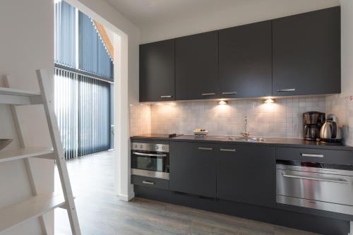 Een keuken of kitchenette bij ParelDuyn