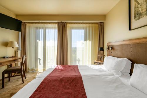 Een bed of bedden in een kamer bij Best Western Vilnius